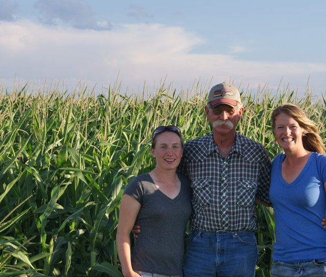 (Left to right) Anna Christenson, the farmer and Alison Whitaker in Nebraska.
