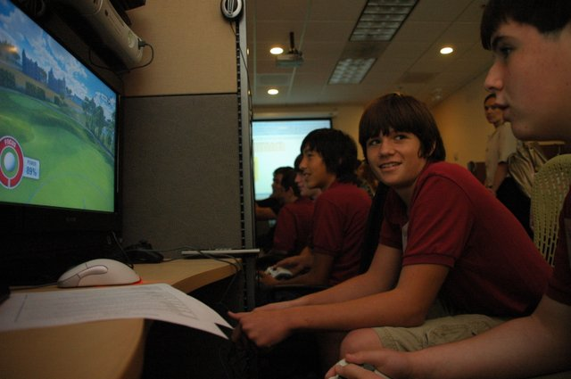 Jacob Dunagan, left, and Cody Hurtnagel, 13, test out a golf video game at Electronic Arts Tiburon Studios in Maitland.