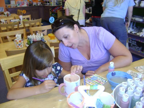 A mother and a daughter work on a gift for dad on Sunday at Painted by Hue in Waterford Lakes. There are lots of ideas for Father's day gifts listed below.