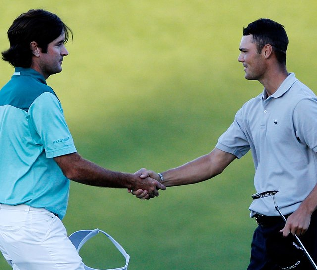 Bubba Watson (left) congratulates Martin Kaymer after Kaymer won the PGA Championship.