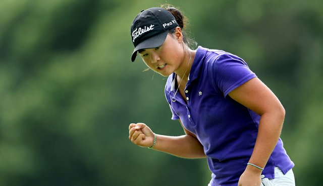 Danielle Kang pumps her fist after making birdie on the 35th hole to win the U.S. Women's Amateur on Aug. 15.