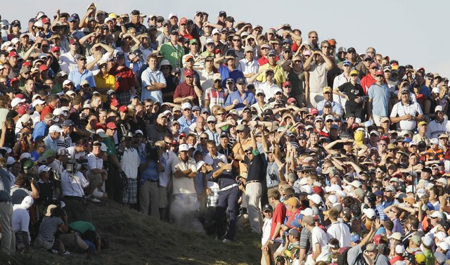 Dustin Johnson hits out of a bunker on the 18th hole during the final round of the PGA Championship.