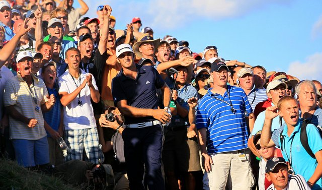 Dustin Johnson hits from a bunker on the 18th hole at Whistling Straits during the final round of the PGA Championship.