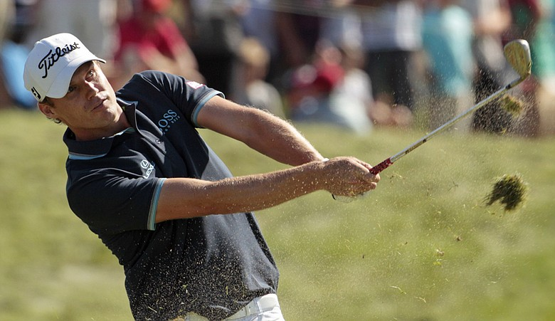 Nick Watney hits a shot on the 10th hole during the final round of the PGA Championship.