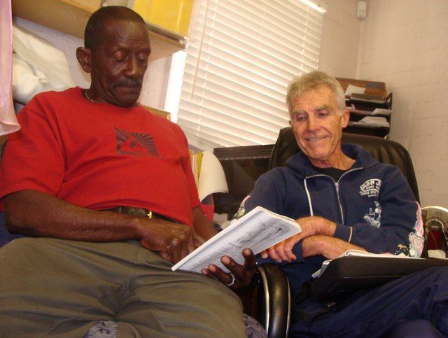 Seventy-year-old James Carter practices reading, in the back office of the Vine Thrift Store in Oviedo, with his 70-year-old teacher Jim Lewis, a retired English teacher who volunteers at the Adult Literacy League.