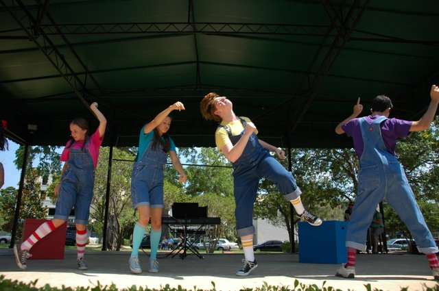 "Players from the Winter Park Playhouse dance up a storm during their production of ""Schoolhouse Rock Jr."" on Saturday morning at Central Park's north stage."