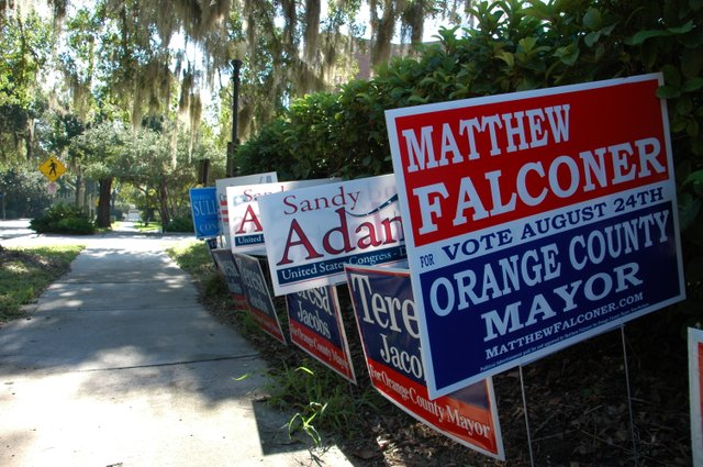 Campaign signs dot the streets of Winter Park, as the candidates scramble for votes leading up to Tuesday's primary.