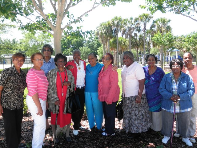 The grandmothers pose after their meeting at the Rock Lake Community Center in Orlando on April 26. Yvonne Friend, far left, and Rounette Fulse, fifth from right, have both helped raise their children's children.