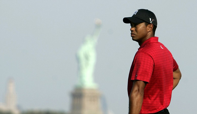 Tiger Woods looks on as Zach Johnson (not pictured) putts on the 14th hole during the final round of The Barclays (2009).