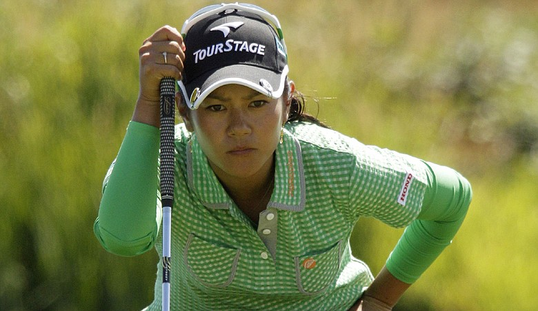 Ai Miyazato prepares to putt on the ninth hole during the first round of the LPGA Safeway Classic.