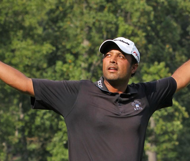 Arjun Atwal celebrates after winning the Wyndham Championship.