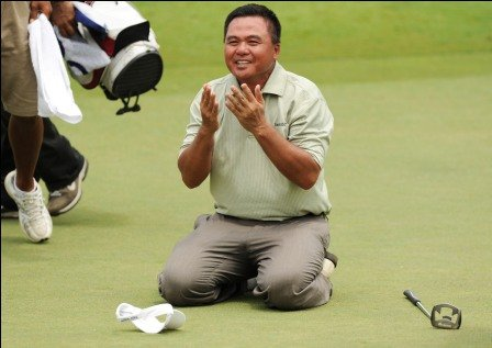Mardan Mamat drops to his knees after holing the winning putt.