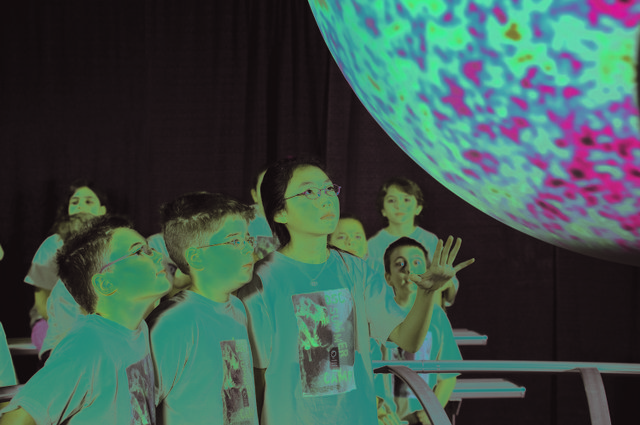 "Children at a past Orlando Science Center spring break camp learn about ""Science on a Sphere."" Many camps are being offered."