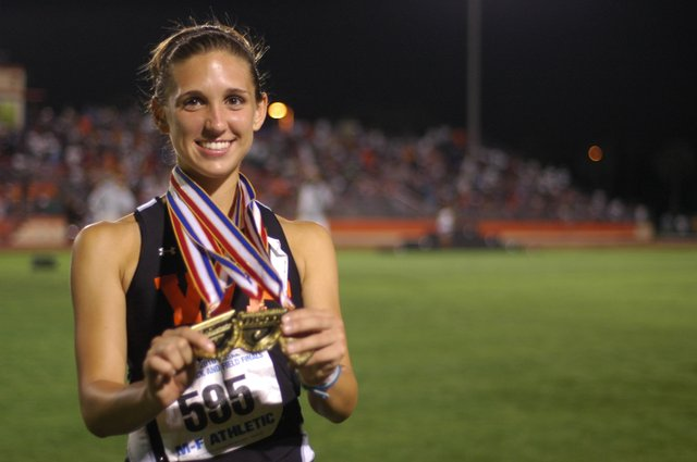 All smiles with three medals in her hands, Winter Park's Shelby Hayes stands on Showalter Field after doing something no class 4A runner has done before.