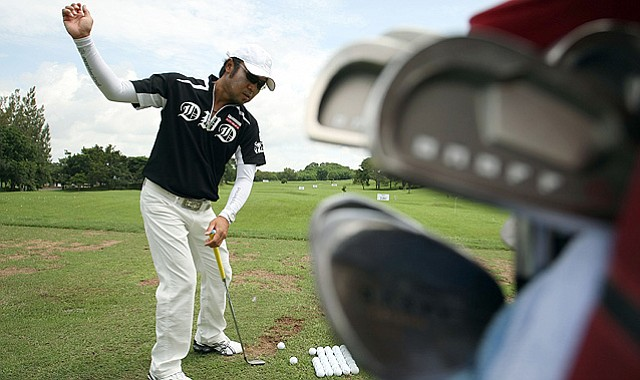 Shingo Katayama of Japan on the practice range before the Thailand Open.