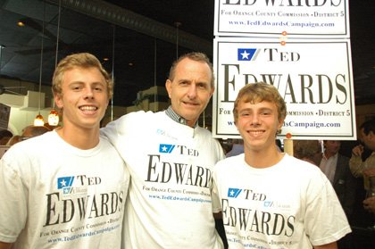Ted Edwards, center, campaigns with his twin sons on Tuesday, just hours before he won the County Commission seat.