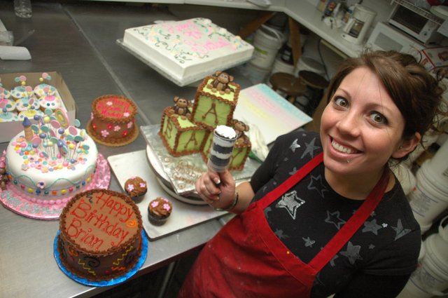 Senior cake artist Jennifer Malave shows off a push-up dessert shot, which Sprinkles Custom Cakes will sell at the Festival of Chocolate, where local chocolatiers face off against each other this Saturday.