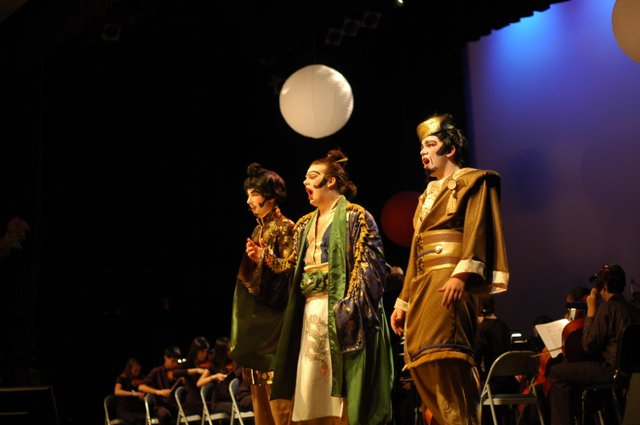 "John Allen co-stars as Koko, center, in Trinity Prep's production of ""The Mikado."" The performance was dedicated to Jonathan May, the school's conductor, who died during the play's production in February."