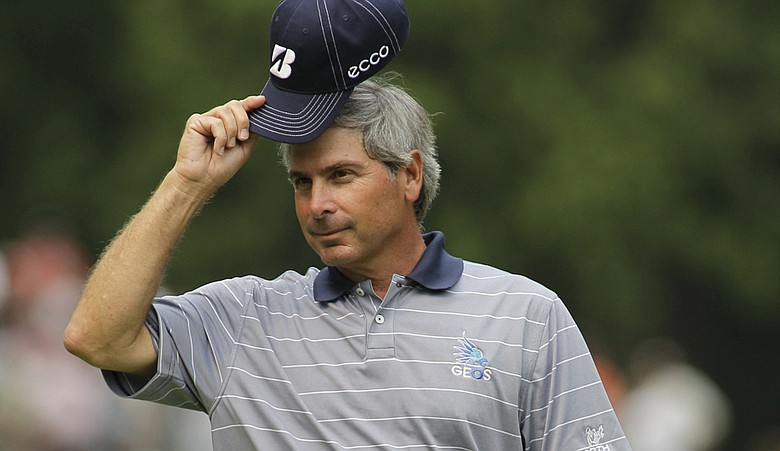 Fred Couples tips his cap at the U.S. Senior Open.