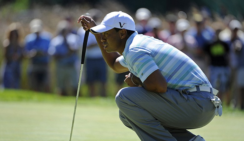 Tiger Woods lines up a putt on the first green during the second round of The Barclays.