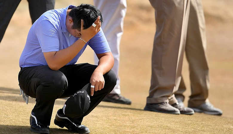 Byeong-Hun An reacts after losing to David Chung in the semifinals of the U.S. Amateur Championship.