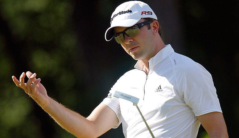 Martin Laird of Scotland reacts to a missed putt on the 14th green during the third round of The Barclays.
