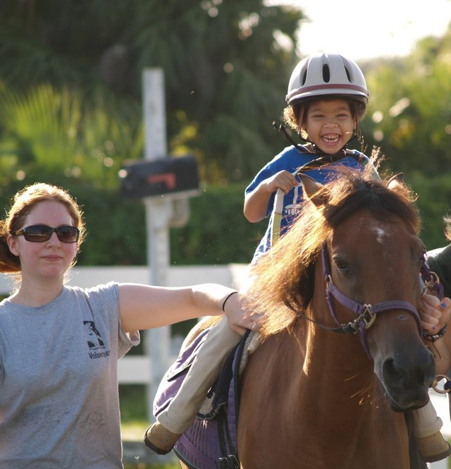 Disabled people connect with horses at Freedom Ride therapeutic horseback riding, which has volunteers and riders from across Central Florida.