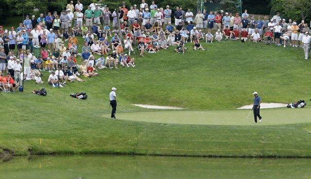 A crowd forms around Tiger Woods' group at the 2010 playing of The Memorial.