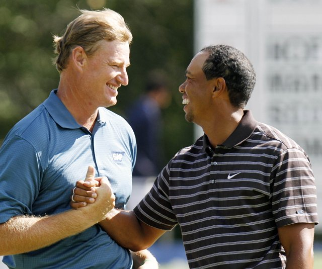 Tiger Woods and Ernie Els shake hands after finishing the third round of the Deutsche Bank Championship.
