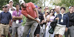 Kuchar, Wi reach top spot in different ways
