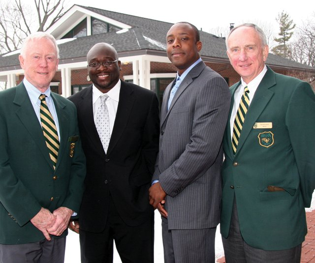 Western Golf Association directors Peter Mone (left) and Tom Mallman (an Evans alumnus) flank brothers Albert and Stephen Akuamoah at Skokie Country Club.