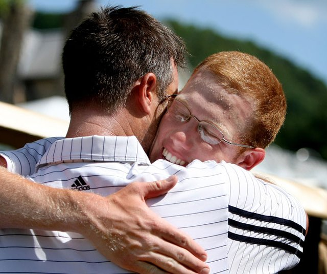 Carter Newman hugs Augusta State coach Josh Gregory after the Jaguars claimed the NCAA Championship.