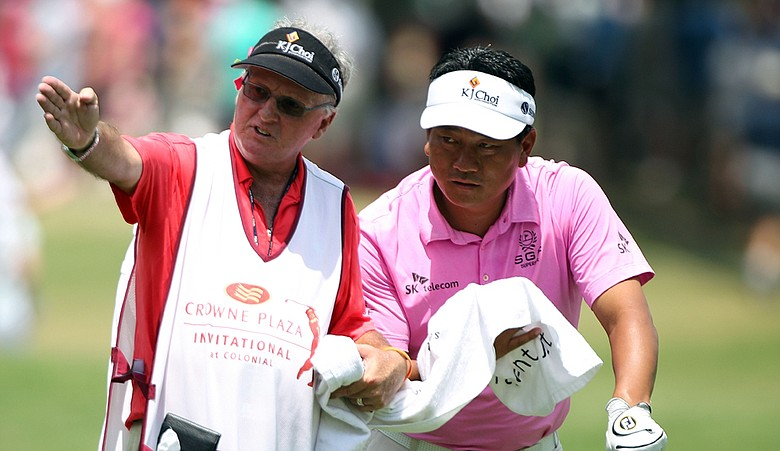 K.J. Choi chats with his caddie Andy Prodger during the third round of the 2010 Crowne Plaza Invitational.