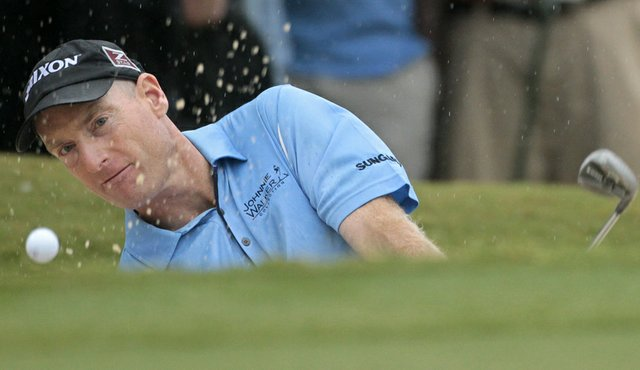 Jim Furyk blasts out of a bunker on the par-3 18th hole during the final round of the 2010 Tour Championship.