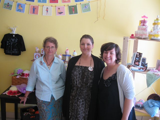 From left, Carol Boldman, Mary Brophy and Anna Ware opened their new store to give parents more clothing options for their kids. Now they're pulling in customers who jog by on the Cross Seminole Trail near their store in Oviedo, which sells clothing made by local artists, including pint-sized accessories.