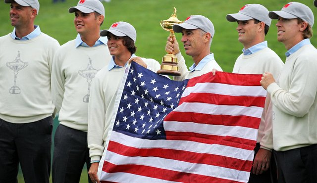 Stewart Cink, Jeff Overton, Rickie Fowler, captain Corey Pavin, Zach Johnson and Hunter Mahan pose with the American flag at the Ryder Cup.