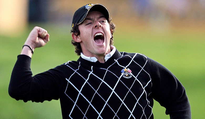 Rory McIlroy celebrates his putt on the 17th green.