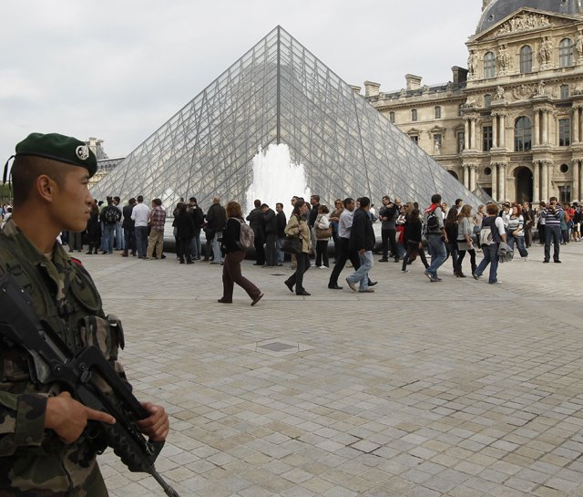 A French soldier patrols around the Louvre in Paris on Sunday.