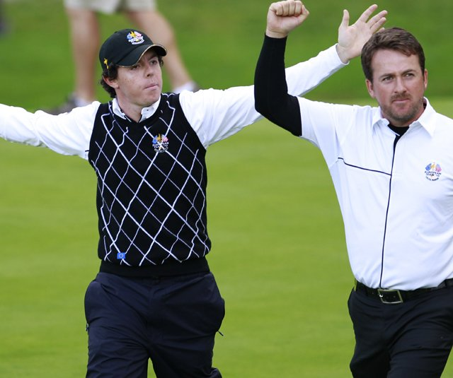 Rory McIlroy and Graeme McDowell celebrate during their third straight team match at the Ryder Cup.