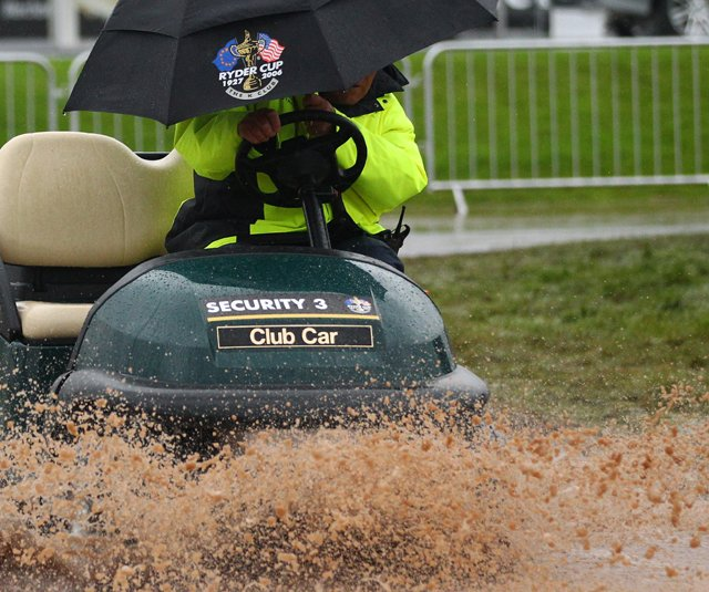 Cart passes through the rain and mud during the weather delay prior to the restart of the fourball and foursomes matches during the 2010 Ryder Cup.