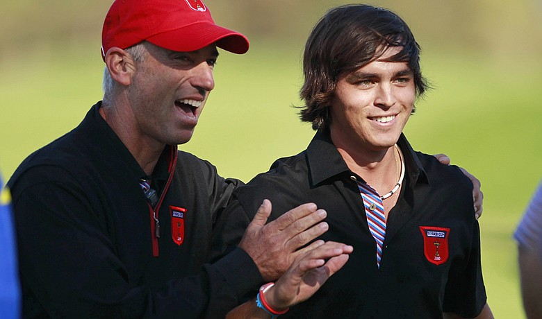 Corey Pavin and Rickie Fowler after Fowler brought his singles match against Edoardo Molinari back to all square.