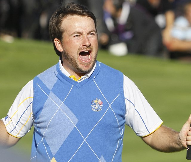 Graeme McDowell celebrates after making a birdie putt on No. 16 during Monday singles. 