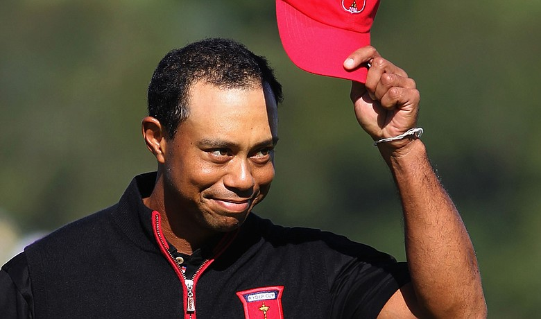 Tiger Woods acknowledges the crowd after holing out for an eagle on No. 12 in the singles matches at the Ryder Cup.