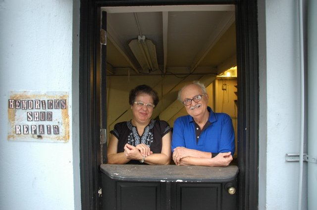 Luther Shakarji, right, and his wife, Clare, reflect on the last three decades on Thursday, Sept. 30, their last day in business. They will miss the community but look forward to retirement.