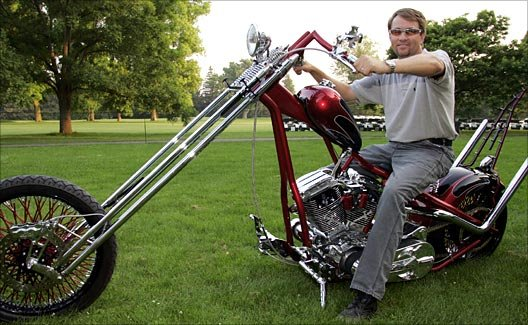 Davis Love III is giving up his prized Orange County Chopper to raise money for charity.