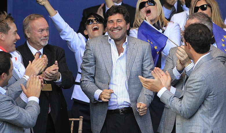 Jose Maria Olazabal (center) is applauded during the trophy presentation at the 2010 Ryder Cup.