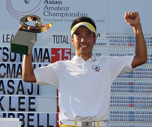 Hideki Matsuyama of Japan stands with the trophy after winning the 2010 Asian Amateur Championship at Kasumigaseki Country Club.