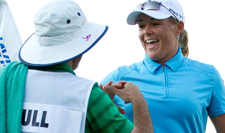 Katherine Hull celebrates with caddie Vern Tess after winning the Navistar LPGA Classic.
