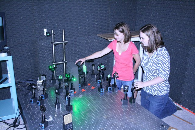 Hagerty High School physics teacher Sarah Zietlow, left, and Rollins College student Ashley Cannaday, right, say they have a 100 percent success rate for detecting dangerous landmines using laser beams.