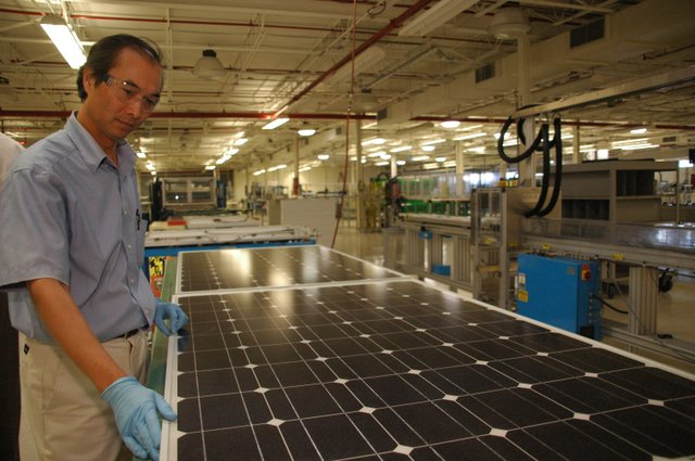 Senior Engineer Dustin Pham inspects a photovoltaic panel at BlueChip Energy's solar panel factory in Lake Mary. With the impending loss of incentives to customers, solar energy is hoping for extended rebates.